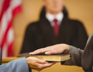 hand on bible courtroom